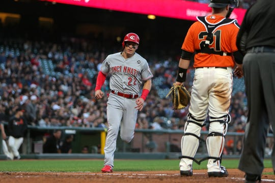 Cincinnati Reds left fielder Derek Dietrich (22) scores a run against the San Francisco Giants during the second inning at Oracle Park.