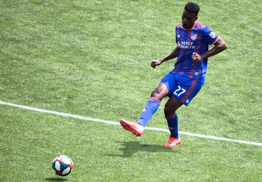 FC Cincinnati midfielder Fatai Alashe (27) passes the ball during the MLS match between FC Cincinnati and Montreal Impact on Saturday, May 11, 2019, in Cincinnati, Ohio.