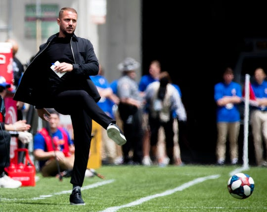 FC Cincinnati head coach Yoann Damet kicks a ball onto the field during the MLS match between FC Cincinnati and Montreal Impact on Saturday, May 11, 2019, in Cincinnati, Ohio.
