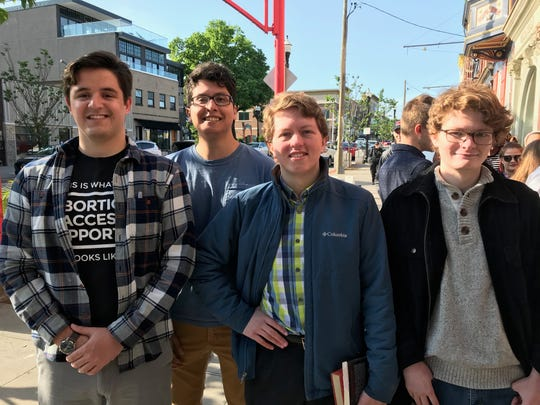 These college students arrived at 6 a.m., five hours before Sen. Elizabeth Warren was set to speak, to be first in line. From left to right: Miami University students Michael Zele, 22, and Anthony Radilla, 20, and University of Cincinnati students and brothers, Gordan and Jake Goodwin, both 21 and both from Terrace Park.