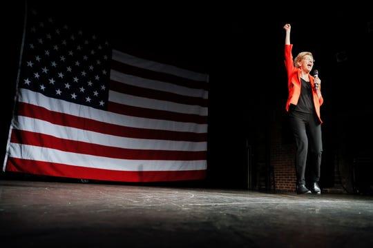 Democratic presidential candidate Sen. Elizabeth Warren, D-Mass., jumps as she speaks during a campaign stop, Saturday, May 11, 2019, in Cincinnati.