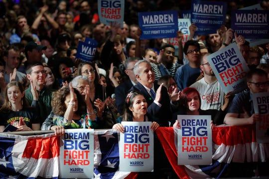 Audience members cheer Democratic presidential candidate Sen. Elizabeth Warren, D-Mass., during a campaign stop, Saturday, May 11, 2019, in Cincinnati.