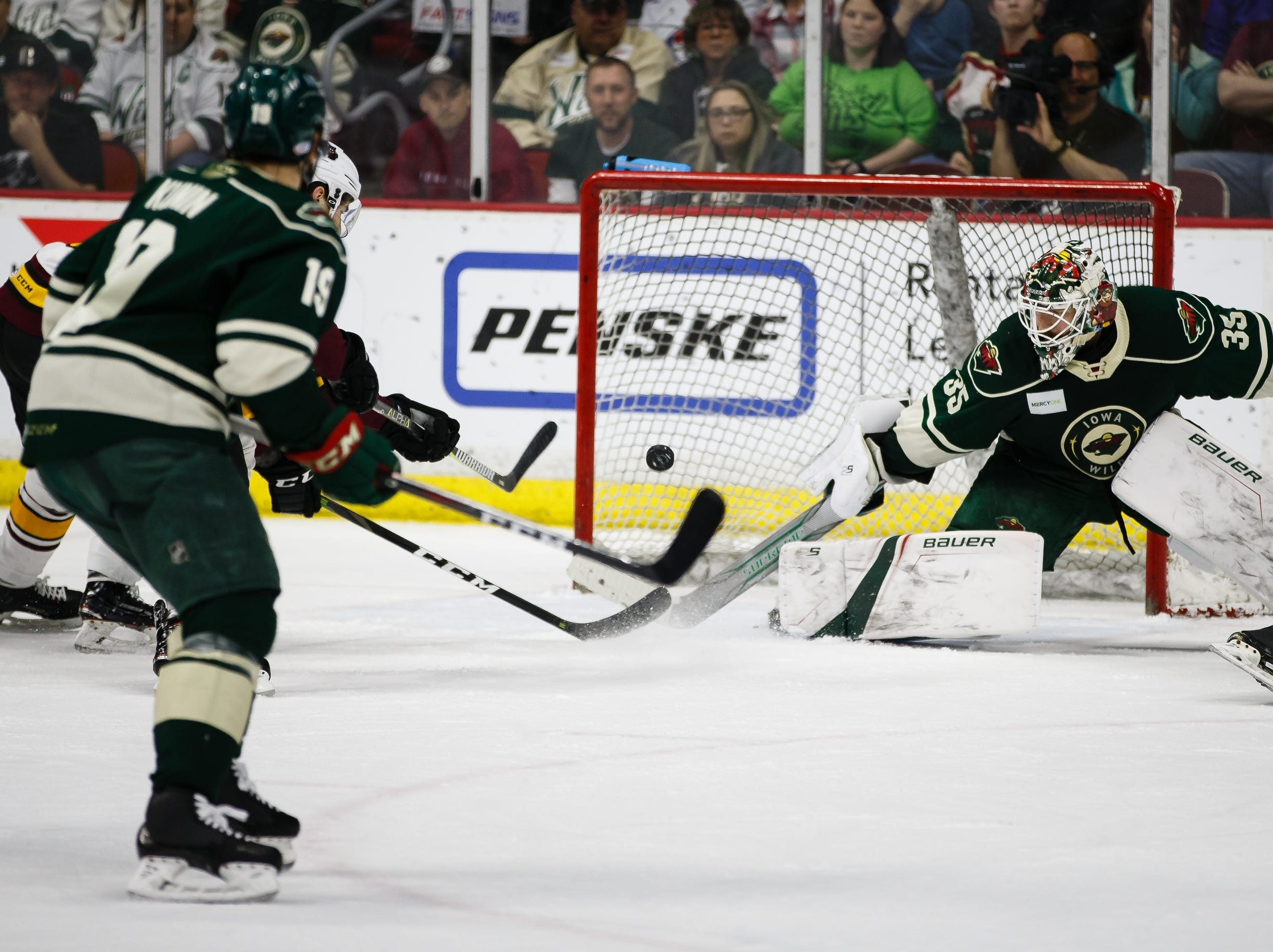 Iowa Wild goalie Andrew Hammond makes a save during Friday's second period of their Calder Cup playoff hockey game against the Chicago Wolves on Friday at Wells Fargo Arena. Hammond madejust 22 saves as the Wolves won 7-4.