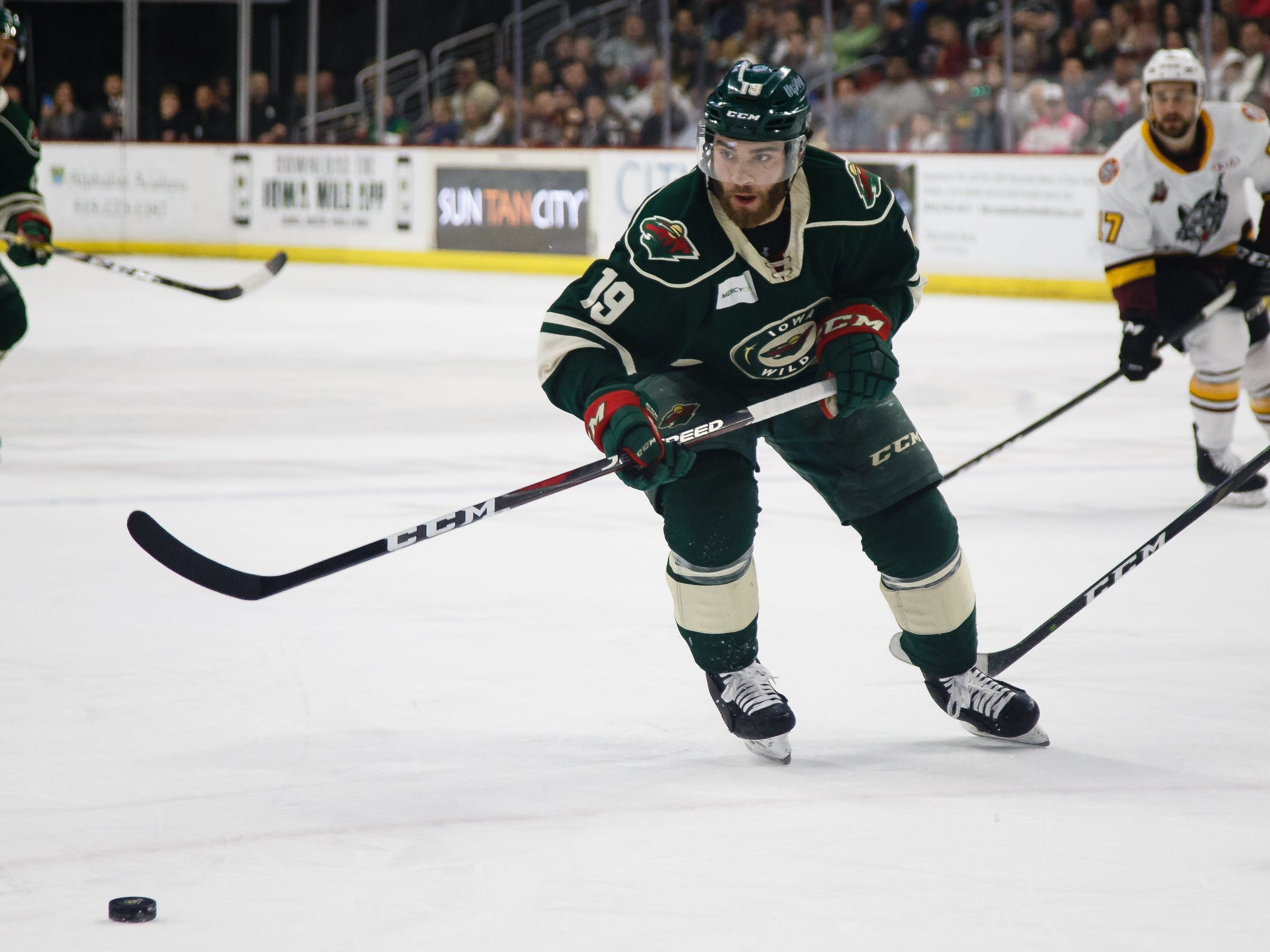The Iowa Wild's Luke Kunin chases down a puck during the second period of their Calder Cup playoff hockey game against the Chicago Wolves on Friday, May 10, 2019, in Des Moines.