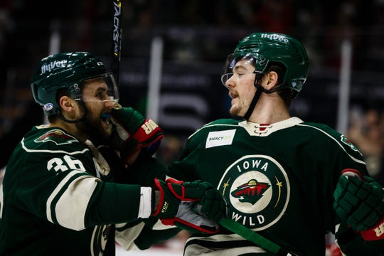 The Iowa Wild's Ryan Donato, right, celebrates with Colton Beck, after he scored to make the score 1-all during their Calder Cup playoff hockey game against the Chicago Wolves on Friday, May 10, 2019, in Des Moines.  Chicago would win the game 7-4 and take a 3-2 advantage in the series.