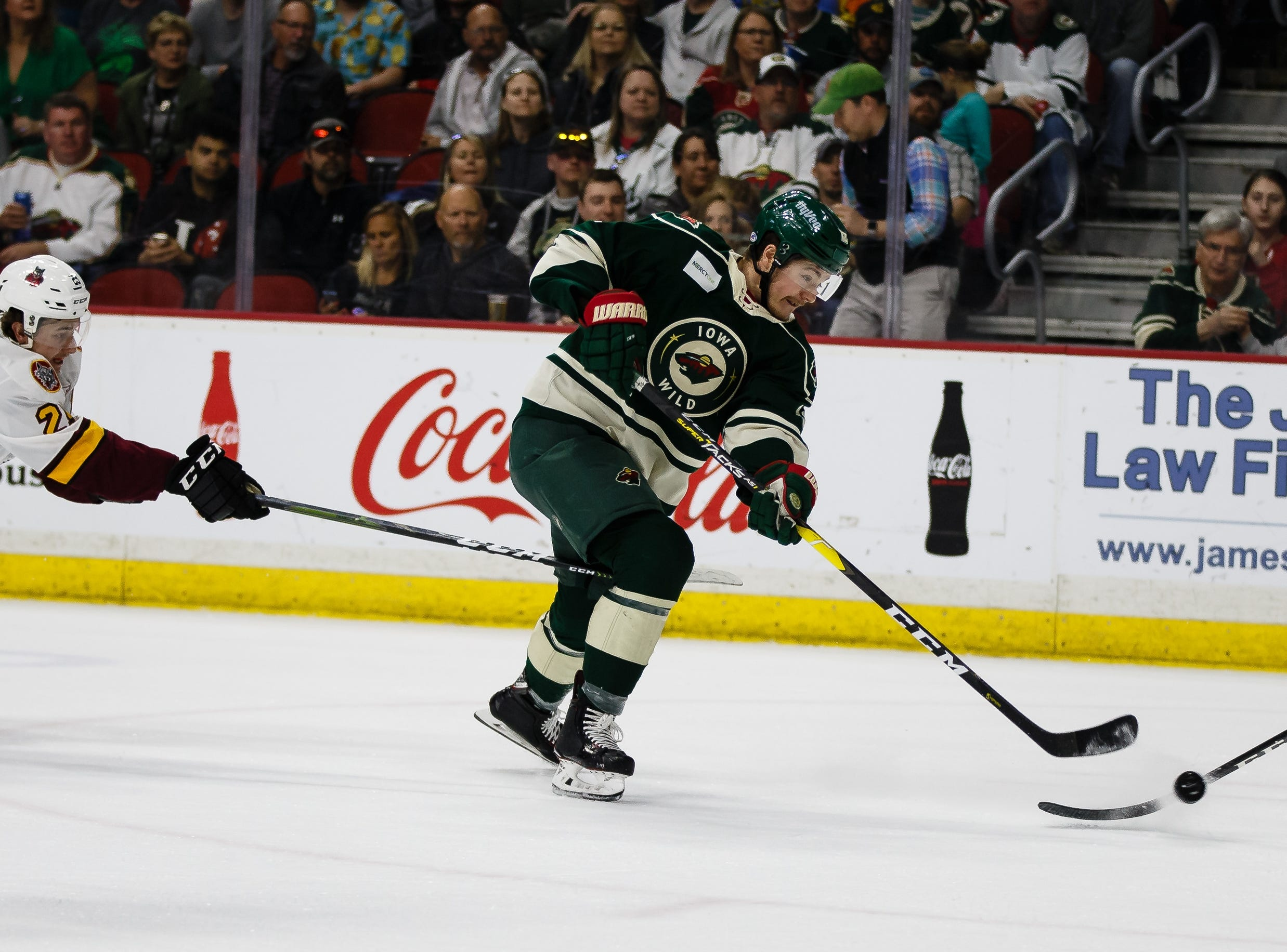 The Iowa Wild's Ryan Donato scores to make the score 1-1 during their Calder Cup playoff hockey game against the Chicago Wolves on Friday, May 10, 2019, in Des Moines.