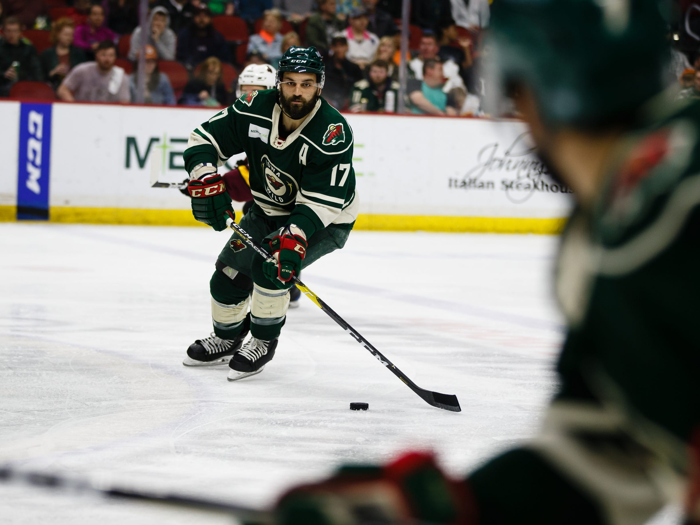 The Iowa Wild's Mike Liambas looks for a pass during the second period of their Calder Cup playoff hockey game against the Chicago Wolves on Friday, May 10, 2019, in Des Moines.