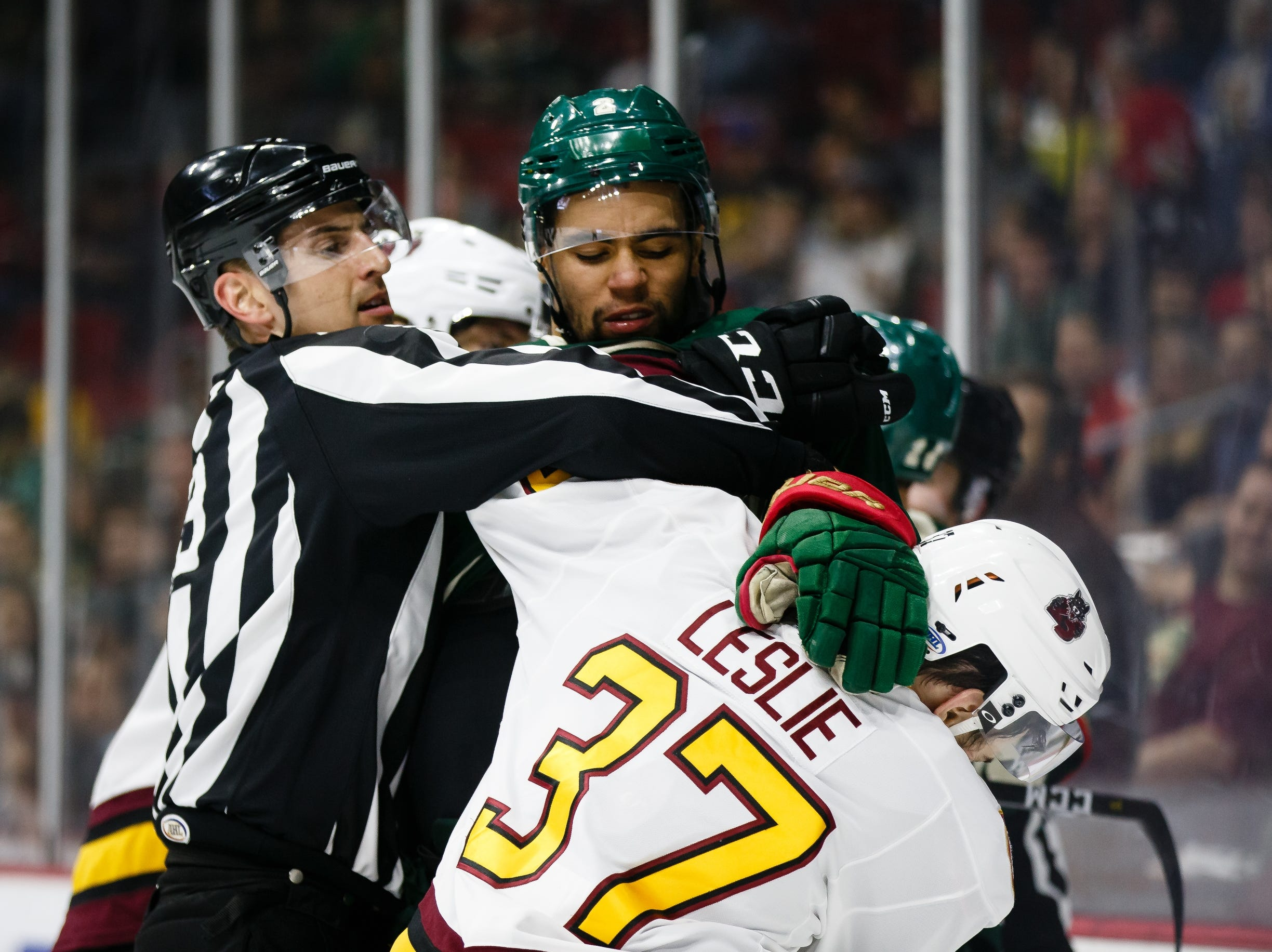 The Iowa Wild's Jordan Greenway fights with the Chicago Wolves Zac Leslie during their Calder Cup playoff hockey game on Friday, May 10, 2019, in Des Moines.
