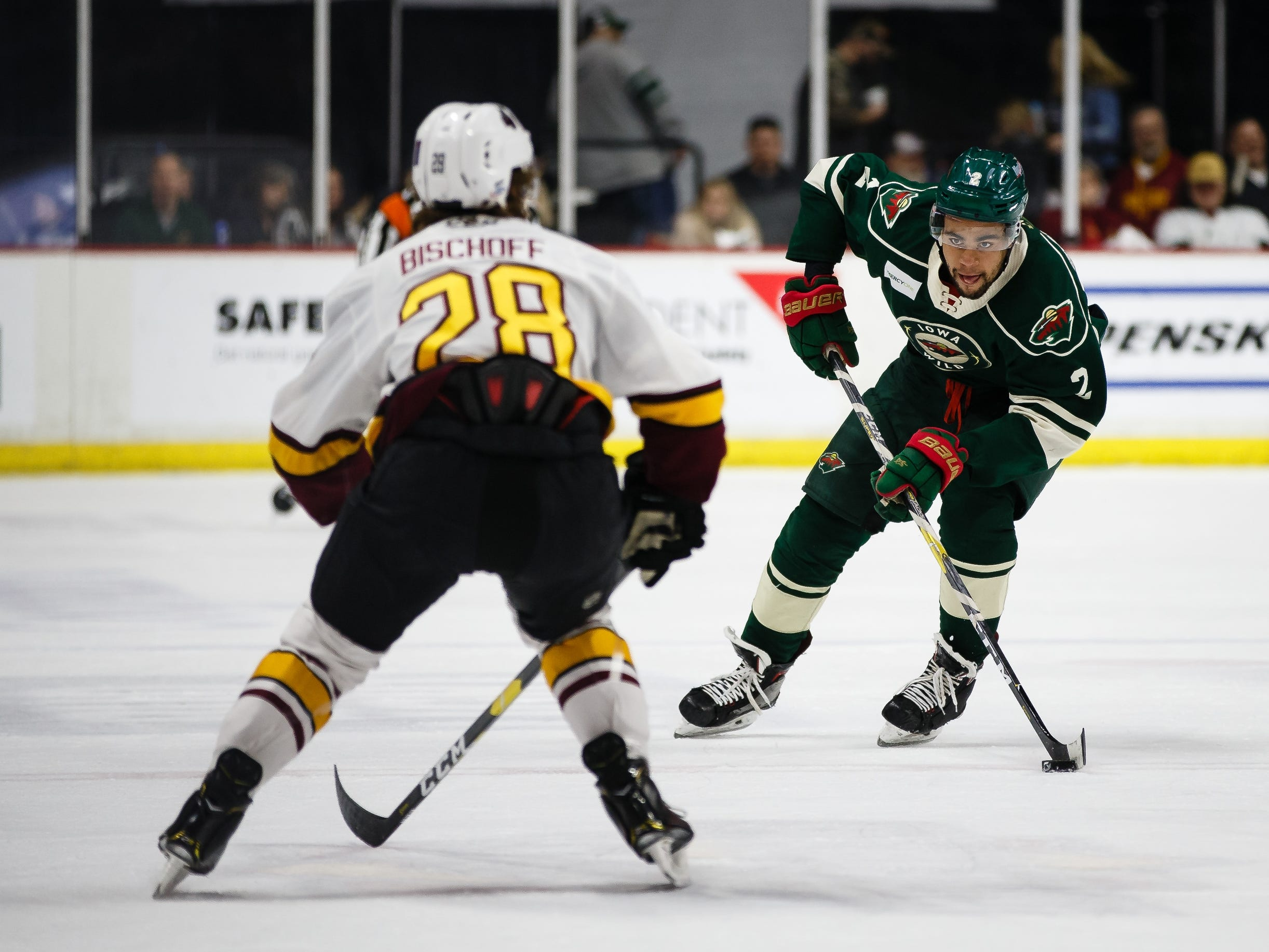 The Iowa Wild's Jordan Greenway brings the puck across center ice during their Calder Cup playoff hockey game against the Chicago Wolves on Friday, May 10, 2019, in Des Moines.