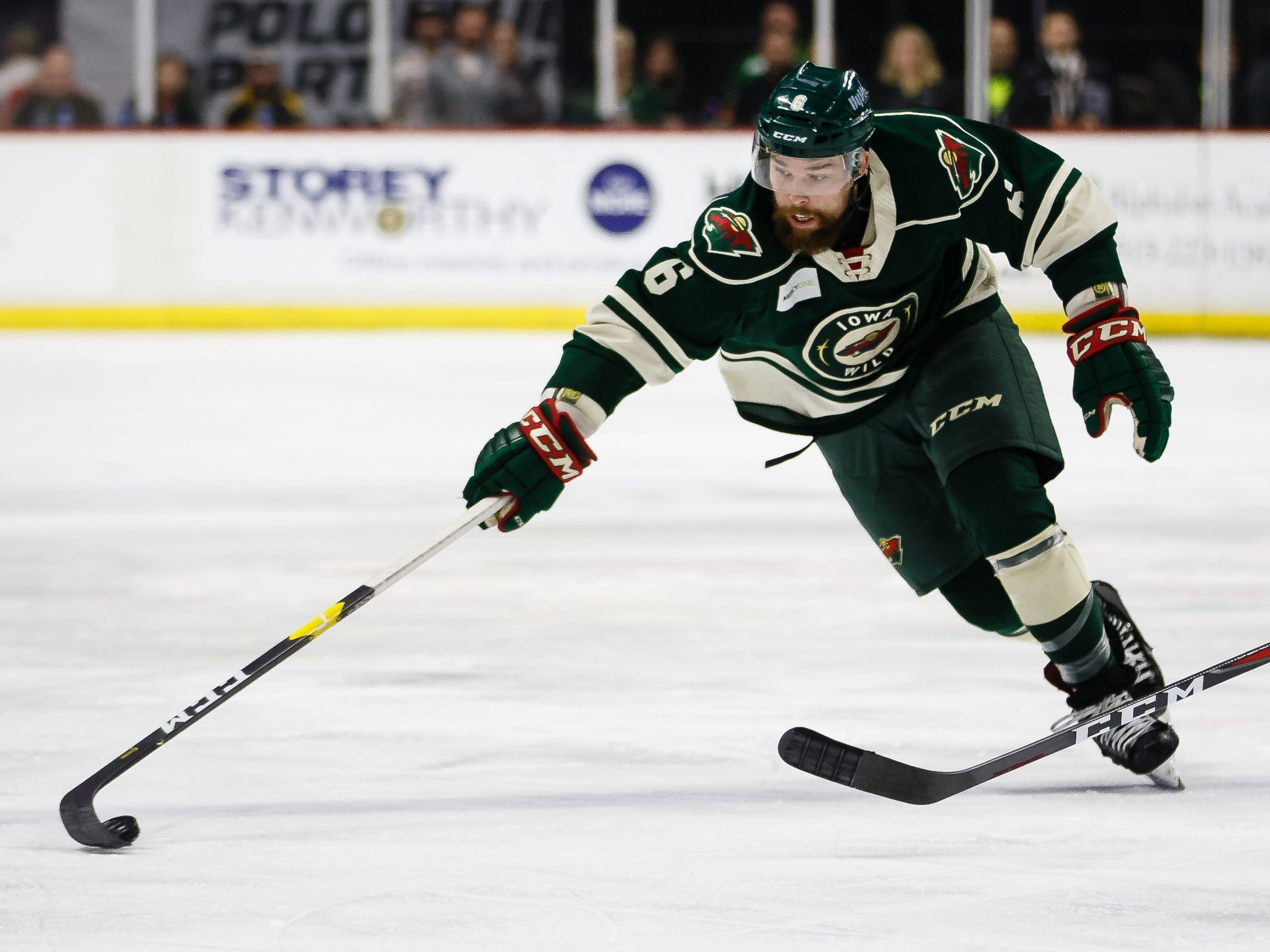 The Iowa Wild's Mitch McLain chases down a puck during their Calder Cup playoff hockey game against the Chicago Wolves on Friday, May 10, 2019, in Des Moines.
