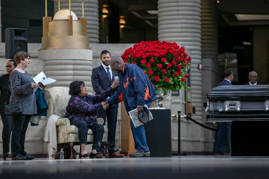 Charlie Jackson, 73, of Eastpointe shakes hands with Debbie Keith, daughter of Judge Damon Keith, of the U.S. Court of Appeals for the 6th Circuit, during Judge Keith's public visitation at the Charles H. Wright Museum of African American History in Detroit on Saturday, May 11, 2019. Jackson says he was Judge Keith's paper carrier.