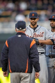 Detroit Tigers starting pitcher Tyson Ross (38) talks with pitching coach Rick Anderson (back to camera) after giving up two runs in the third inning against the Minnesota Twins at Target Field on Friday, May 10, 2019, in Minneapolis.