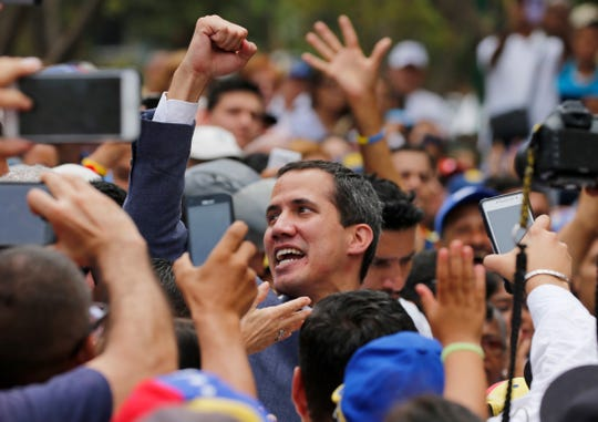Venezuela's opposition leader and self-proclaimed interim president Juan Guaido holds up his right fist symbolizing solidarity during a rally in Caracas, Venezuela, Saturday, May 11, 2019.