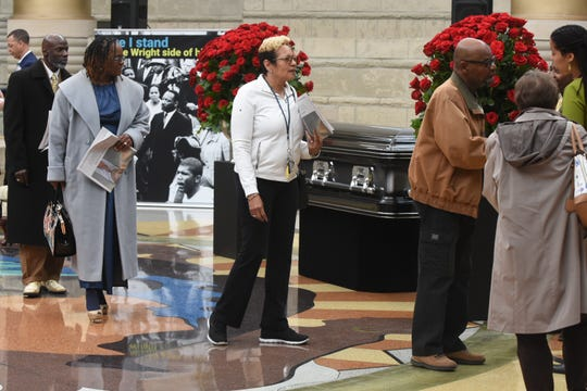 Mourners pass the casket of the Honorable Damon J. Keith during public visitation at the Charles H. Wright Museum of African American History on Saturday.