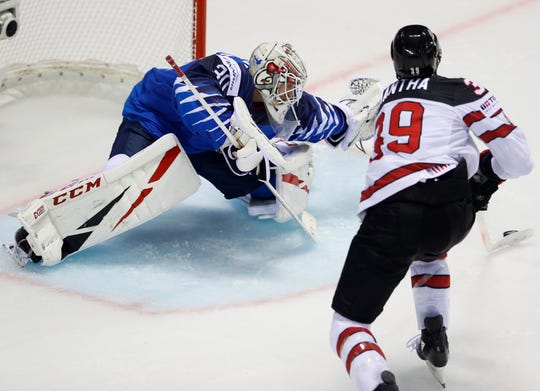 Finland goaltender Kevin Lankinen makes a save against Canada's Anthony Mantha during a World Championships Group A match Friday.