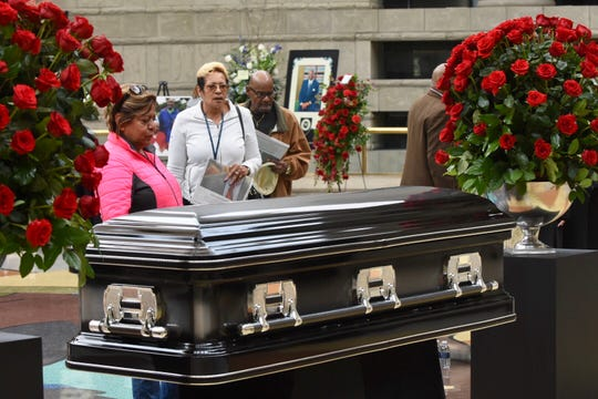 Mourners stand at the casket of the late Judge Damon J. Keith on Saturday.