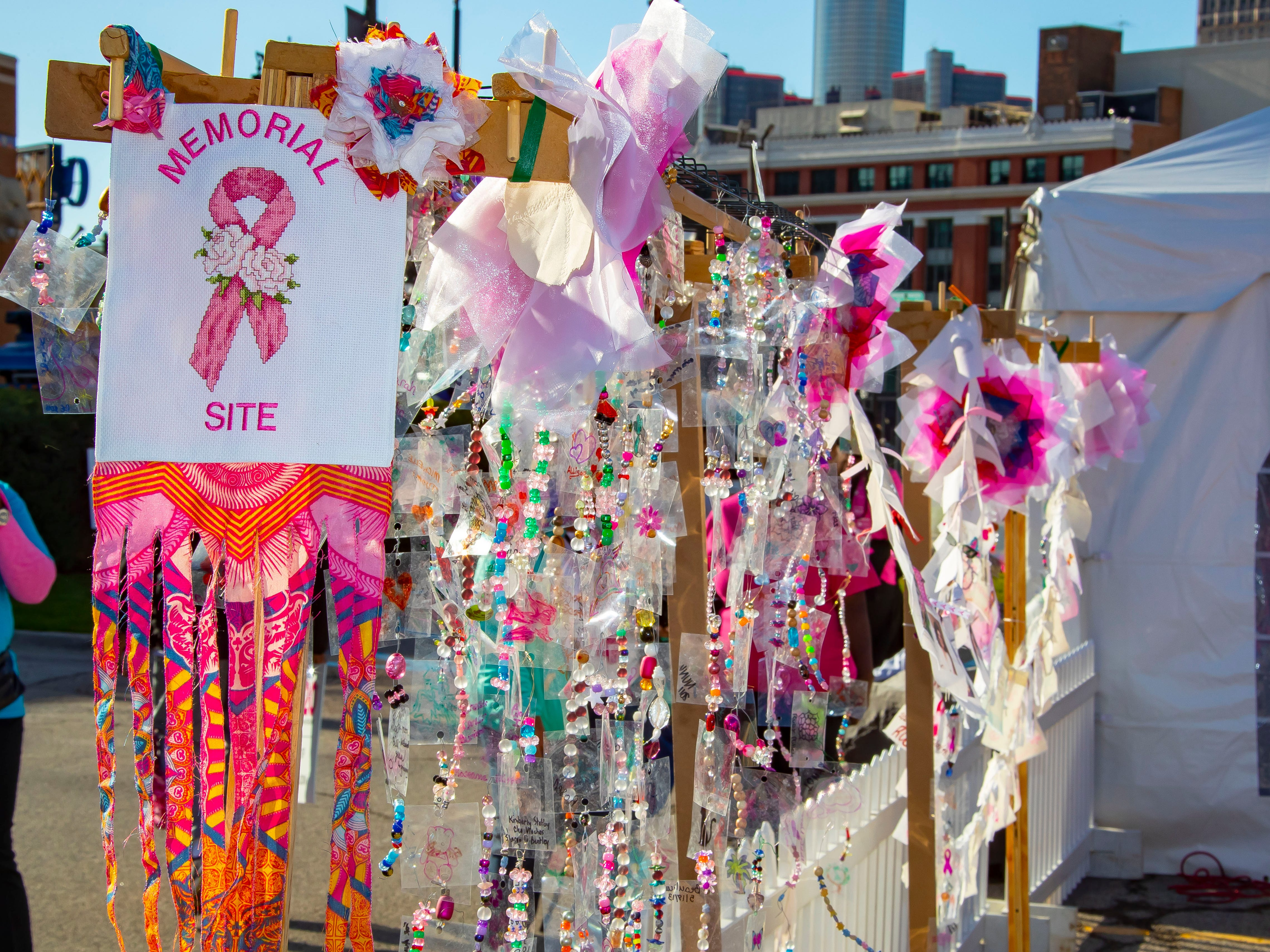 A memory rack for participants to hang mementos honoring loved ones that lost their battle with cancer during the Susan G. Komen Race for the Cure at Comerica Park in Detroit Michigan. (Photo by Dave Reginek-Special to Detroit News)