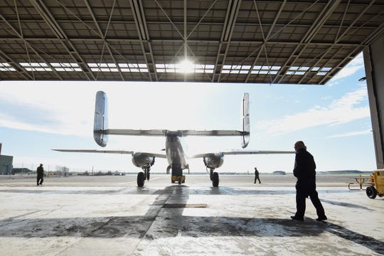 The B-25D Mitchell Bomber leaves Hangar 1 Saturday at Willow Run Airport.