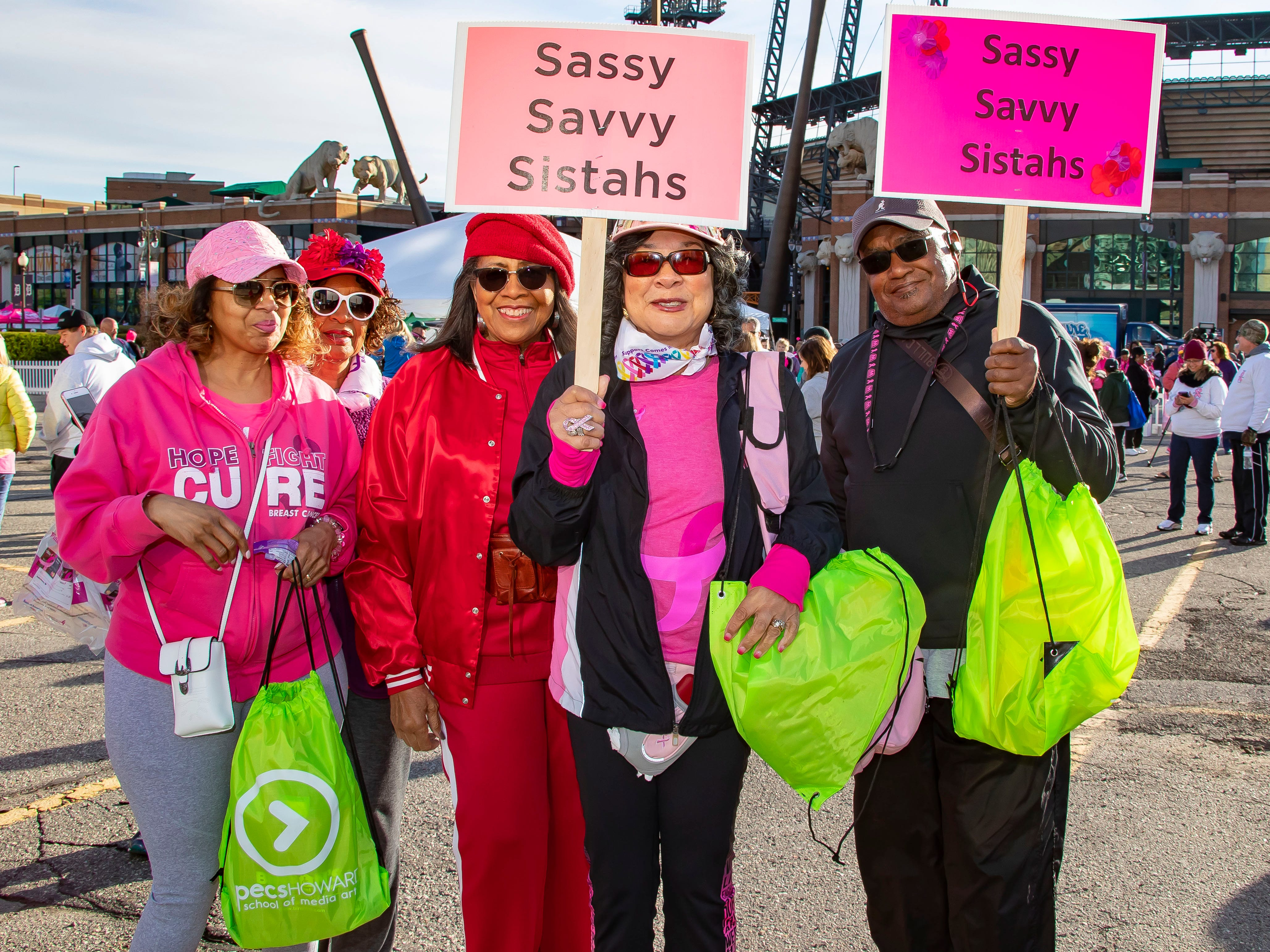 29 year cancer survivor Patricia Wilson (C) from Arizona, holds up here sign with family by her during the Susan G. Komen Race for the Cure at Comerica Park in Detroit Michigan. (Photo by Dave Reginek-Special to Detroit News)