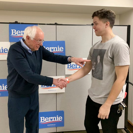 In this May 4, 2019 photo provided by the Bernie Sanders campaign, presidential candidate Sen. Sanders, I-Vt., shakes hands with supporter Ashton Ayers in Ames, Iowa.