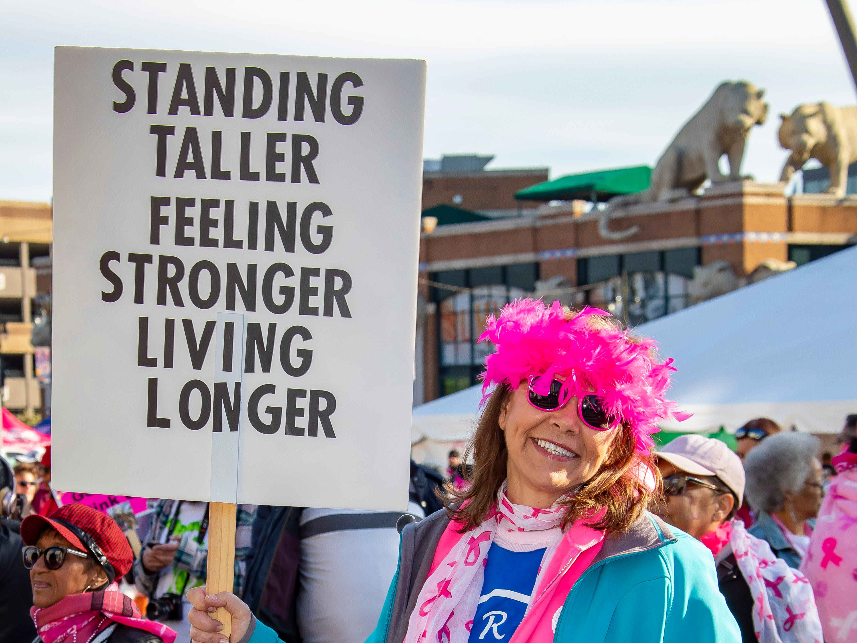 A supporter of the Susan G. Komen Race for the Cure holds up her sign for a picture at Comerica Park in Detroit Michigan. (Photo by Dave Reginek-Special to Detroit News)