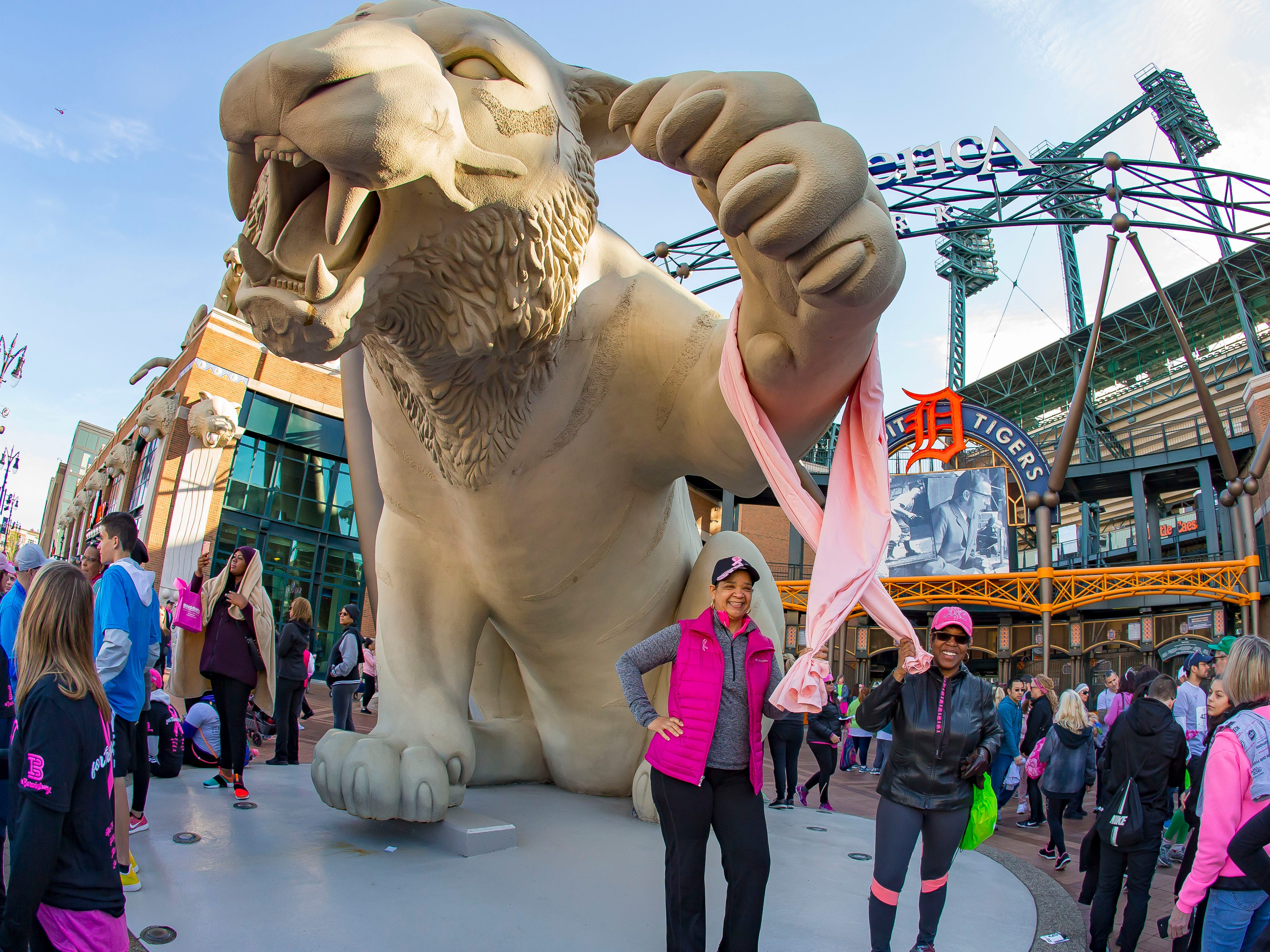 Five year cancer survivor April Shows (L) and her friend Jakki Nelson pose for a picture in front of Comerica Park during the Susan G. Komen Race for the Cure in Detroit Michigan. (Photo by Dave Reginek-Special to Detroit News)