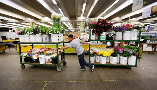 Julio Barajas moves a load of flowers at the Southern California Flower Market in Los Angeles in October 2016. Mother's Day is the busiest holiday of the year for the floral industry.
