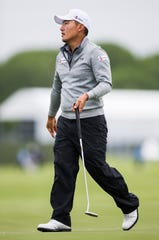 Sung Kang reacts after sinking a putt on the 18th green during the second round of the Byron Nelson on Friday.