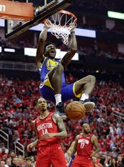 Warriors forward Jordan Bell (2) scores over Rockets guard Gerald Green during the first half of Game 6 on Friday.