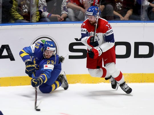 Sweden's Oliver Ekman Larsson, left, passes in front of the Czech Republic's Filip Hronek during a World Championships Group B match Friday.
