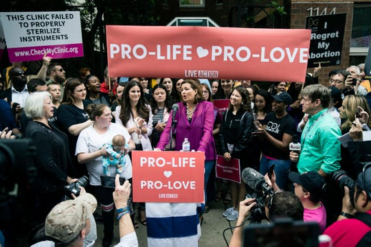 Ashley Garecht speaks as anti-abortion protesters rally near a Planned Parenthood clinic in Philadelphia, Friday, May 10, 2019.
