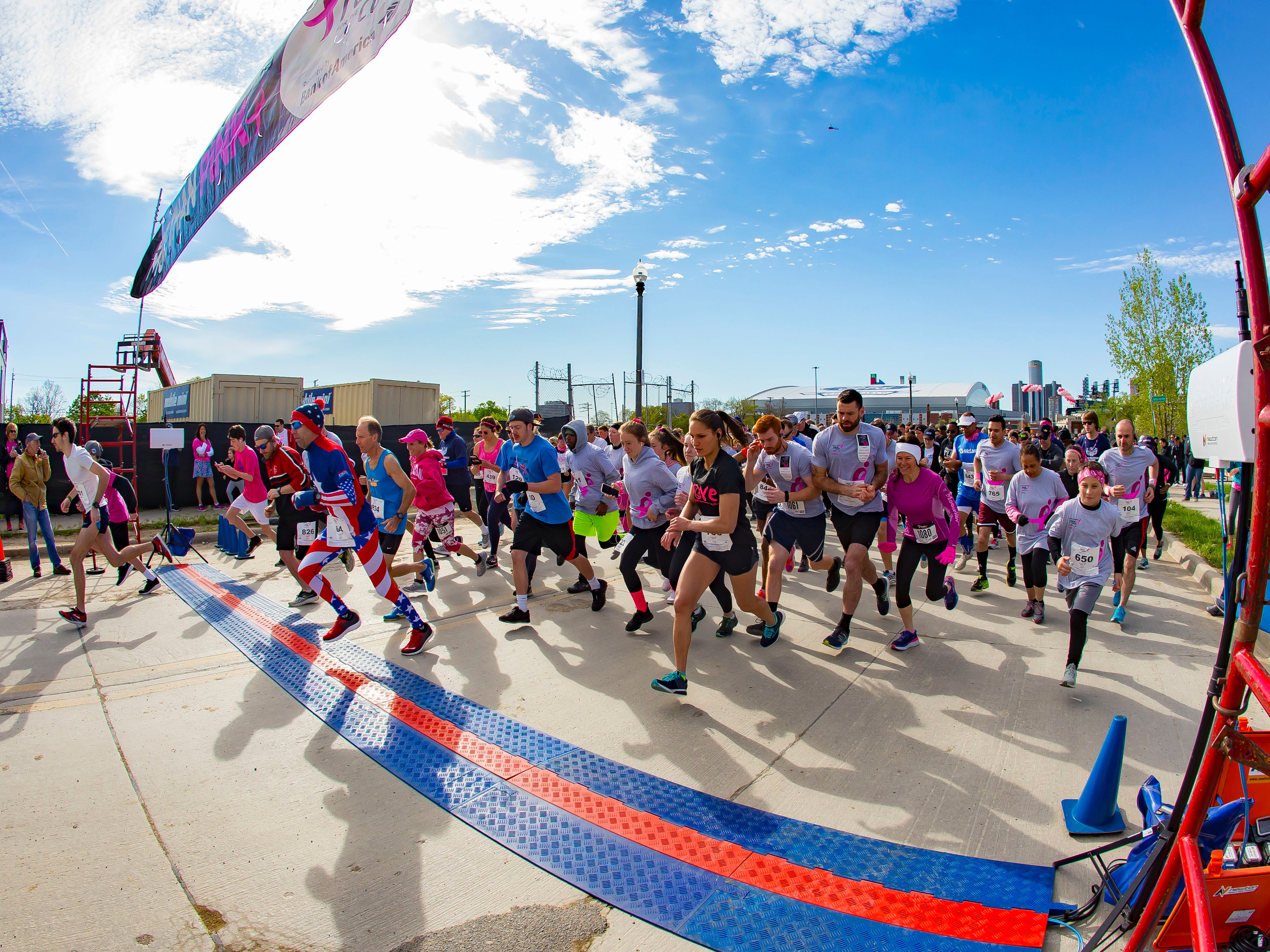 Participants start their 5K race/walk during the Susan G. Komen Race for the Cure at Comerica Park in Detroit Michigan. (Photo by Dave Reginek-Special to Detroit News)