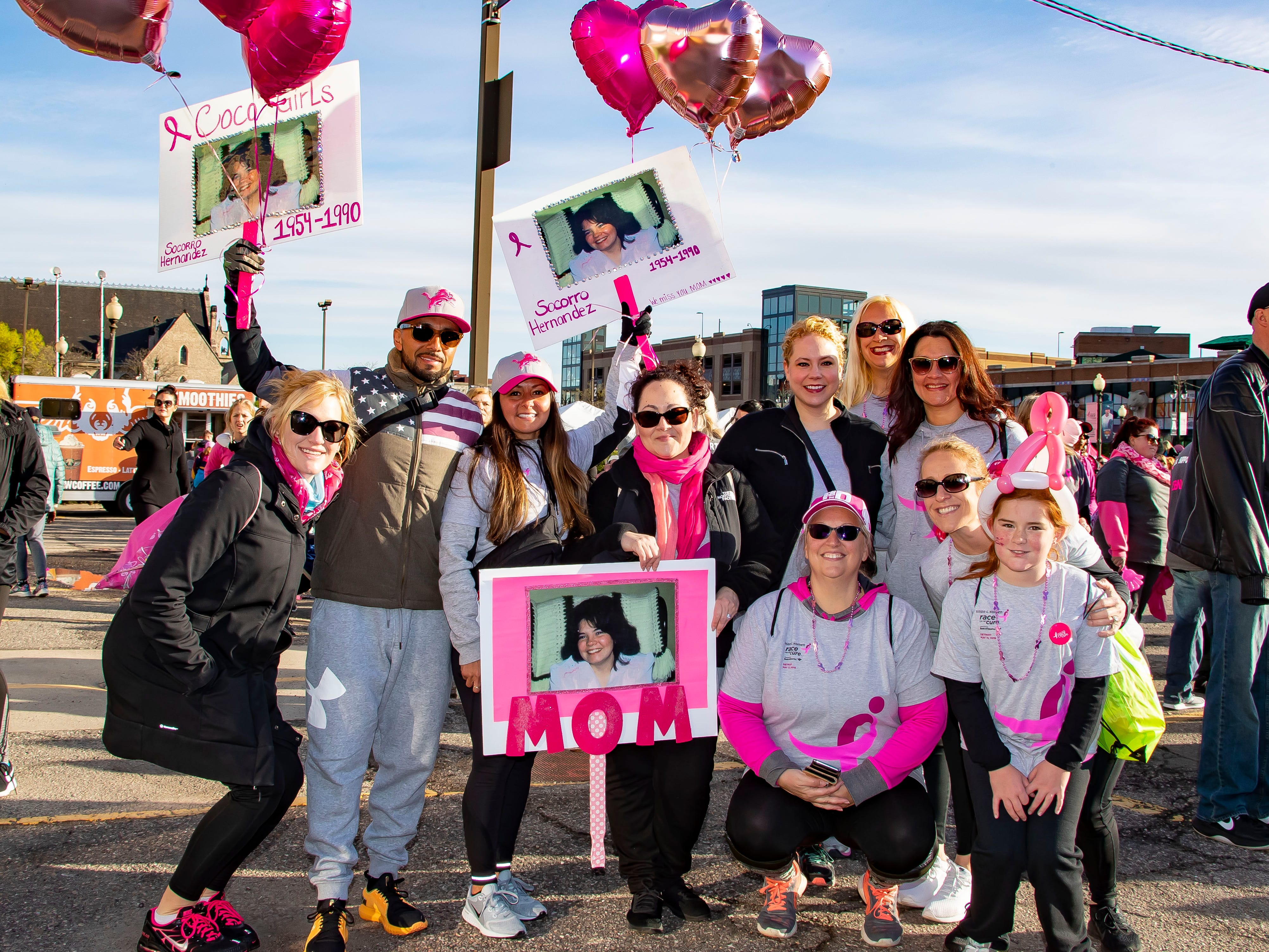 The Detroit family of Coco Hernandez, who lost her battle with cancer in 1990, pose for a picture during the Susan G. Komen Race for the Cure at Comerica Park in Detroit Michigan. The family has been coming to this event annually since 2001. (Photo by Dave Reginek-Special to Detroit News)