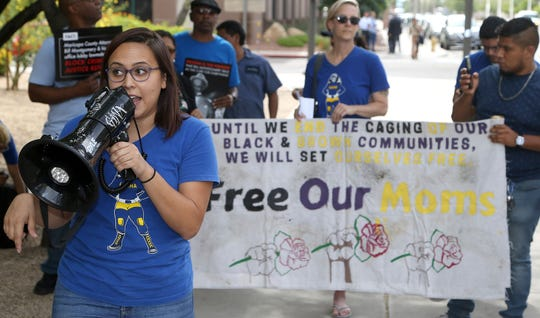 Protesters gather in front of Maricopa County Attorney Bill Montgomery's office Thursday, May 9, 2019, in Phoenix.