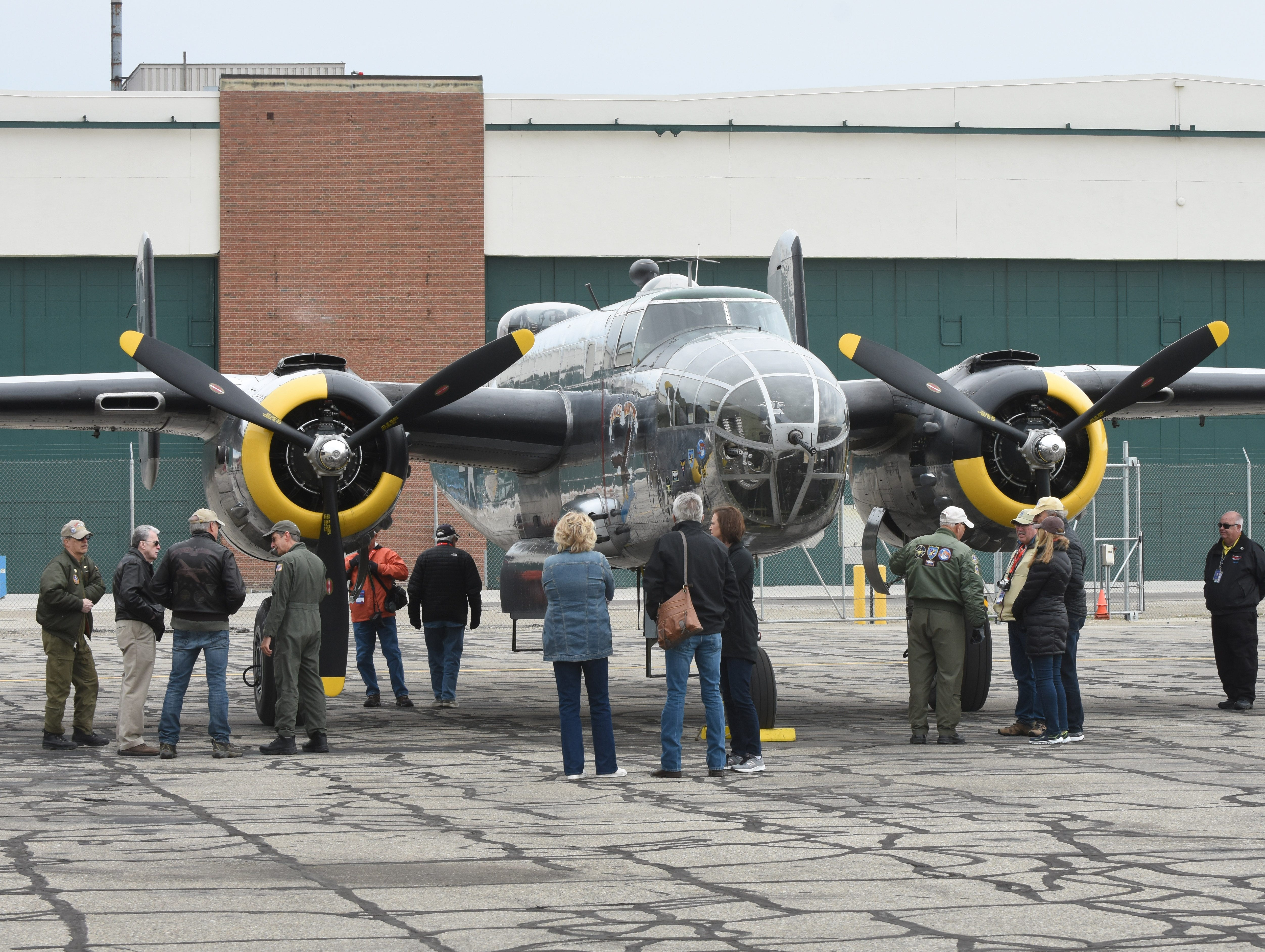 The World War II B-25 Mitchell Yankee Warrior is surrounded by admirers at Willow Run Airport.