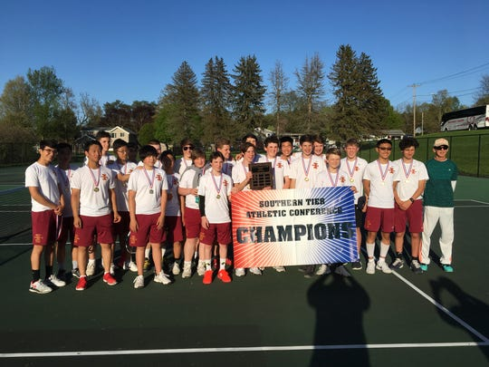 The Ithaca boys tennis team after a 7-0 win over Vestal in the Southern Tier Athletic Conference tournament finals May 6, 2019.