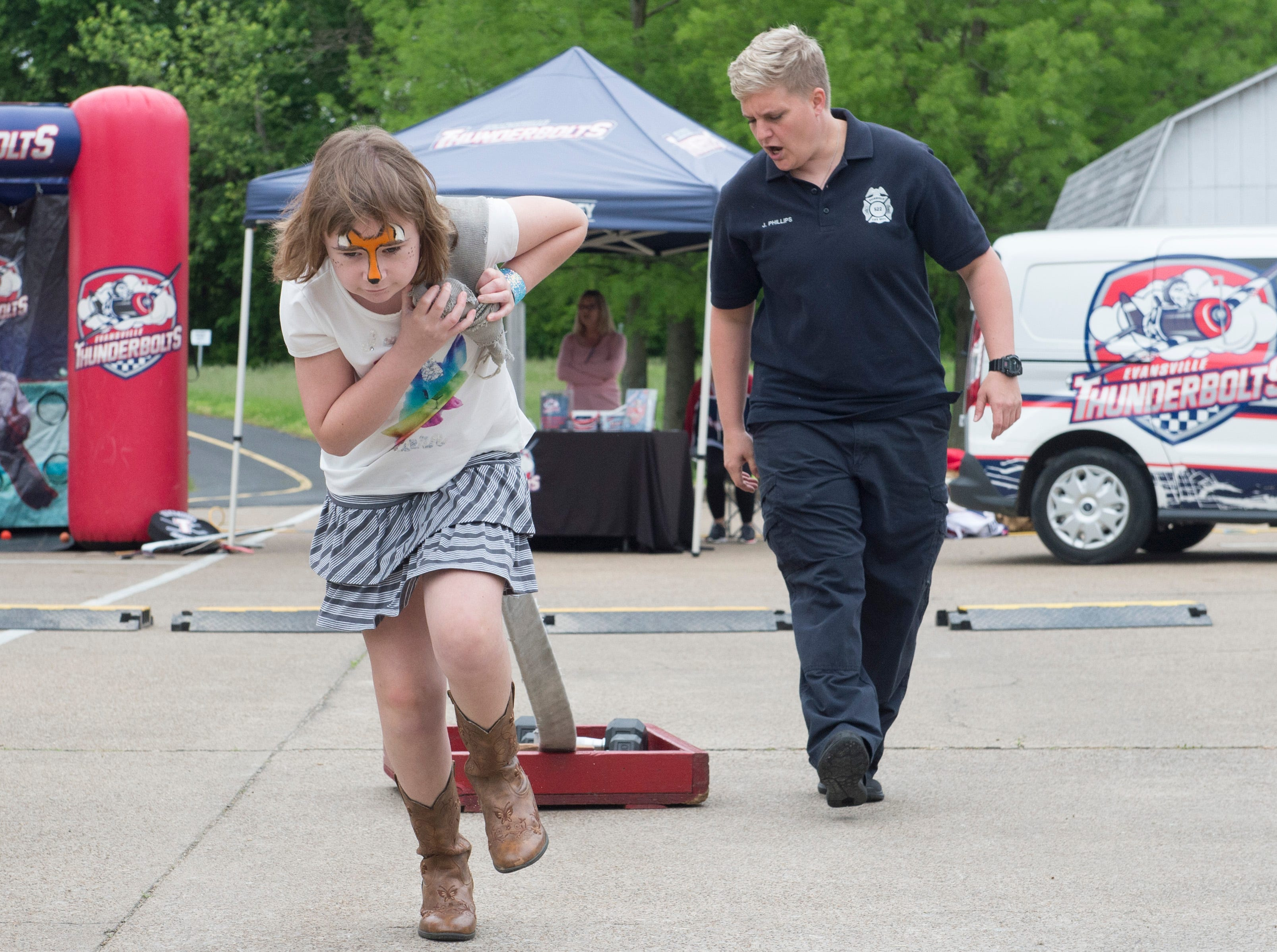 Lilly Carrico, 12, pulls a sled while running through the firefighting kiddie combat challenge activity during the 2019 Spirit Fest Saturday, May 11, 2019. Spirit Fest is a day of fun and activities that benefits the Spirit Medical Fund which raises money for the Evansville Animal Care and Control shelter.
