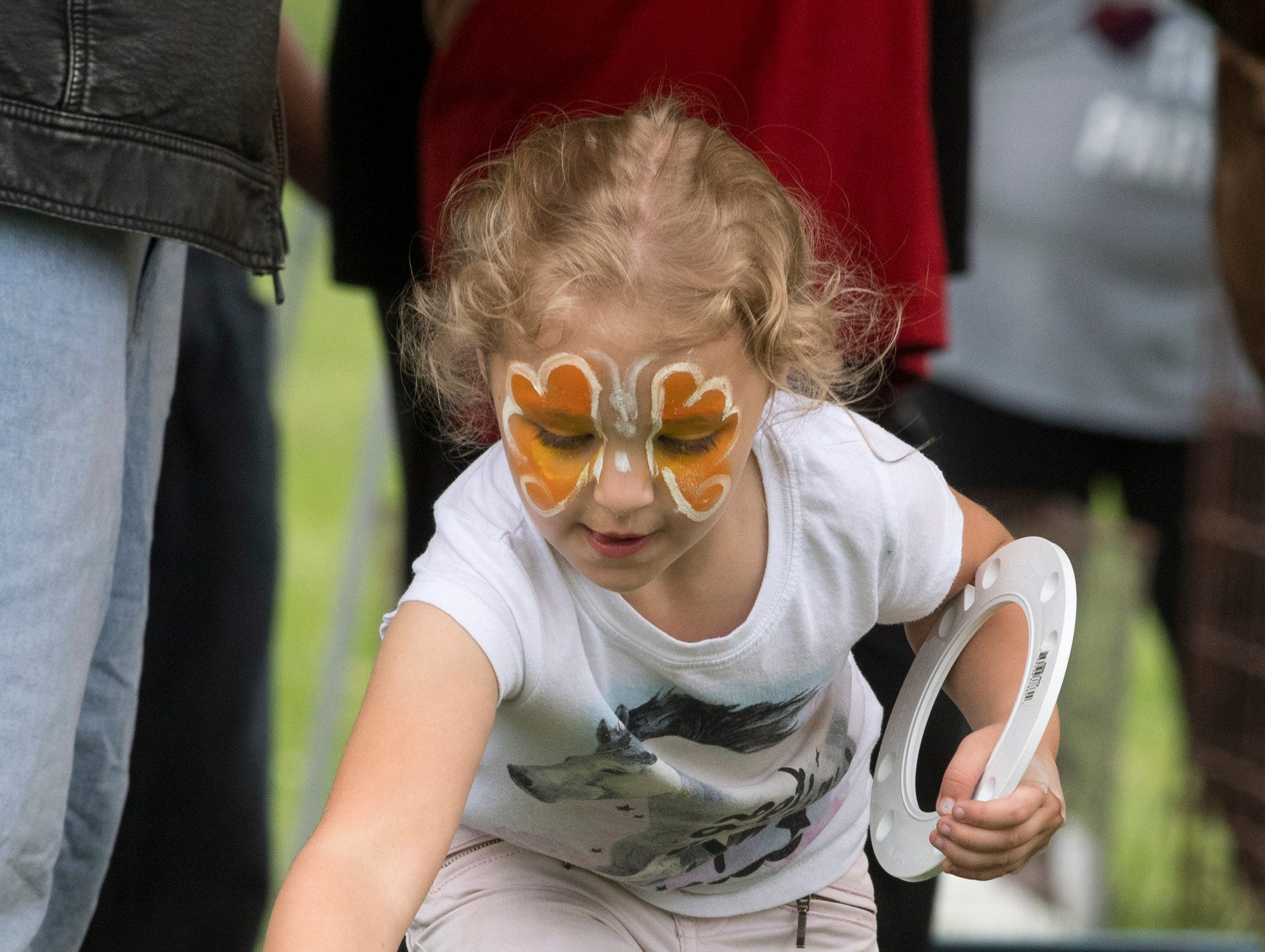 Naomi Storch, 5, throws a ring on a bottle of bubbles during the 2019 Spirit Fest Saturday, May 11, 2019. Spirit Fest is a day of fun and activities that benefits the Spirit Medical Fund which raises money for the Evansville Animal Care and Control shelter.
