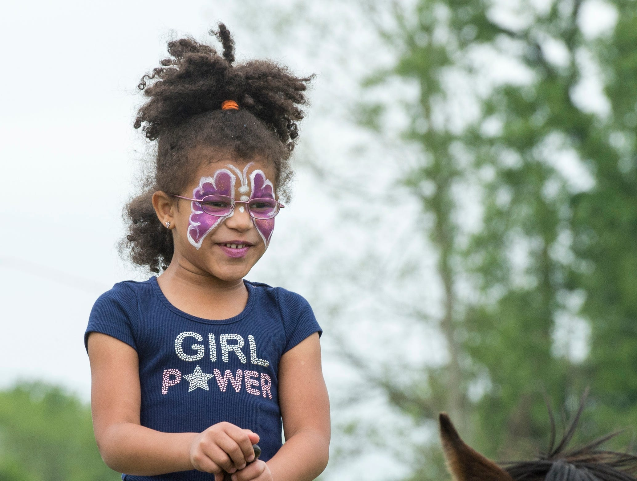 Alanna Gernigan, 6, rides Porter, a rescued offtrack thoroughbred horse from Ellis Park, during the 2019 Spirit Fest Saturday, May 11, 2019. Spirit Fest is a day of fun and activities that benefits the Spirit Medical Fund which raises money for the Evansville Animal Care and Control shelter.