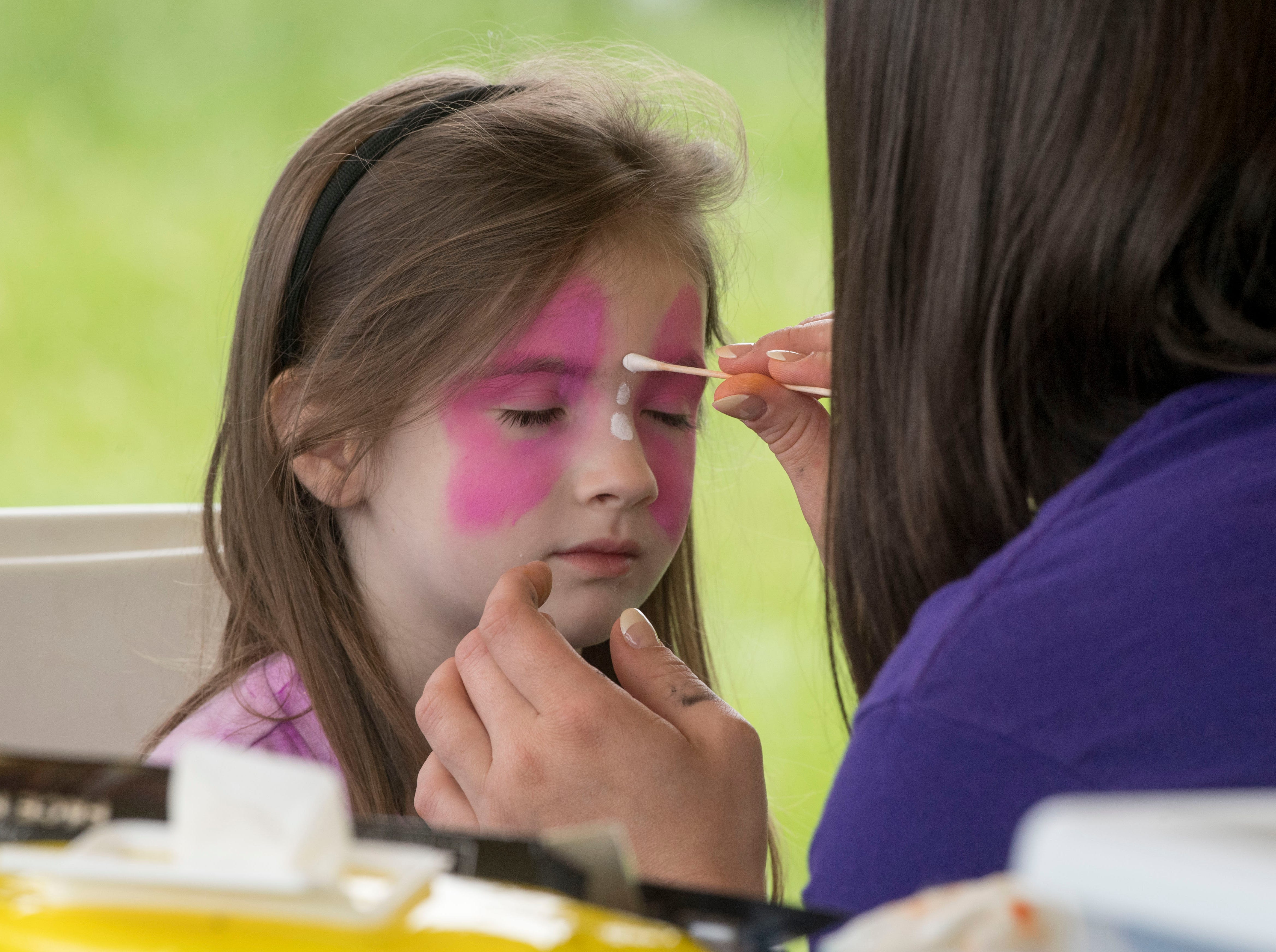 Julia West, 5, gets her face painted during the 2019 Spirit Fest Saturday, May 11, 2019. Spirit Fest is a day of fun and activities that benefits the Spirit Medical Fund which raises money for the Evansville Animal Care and Control shelter.