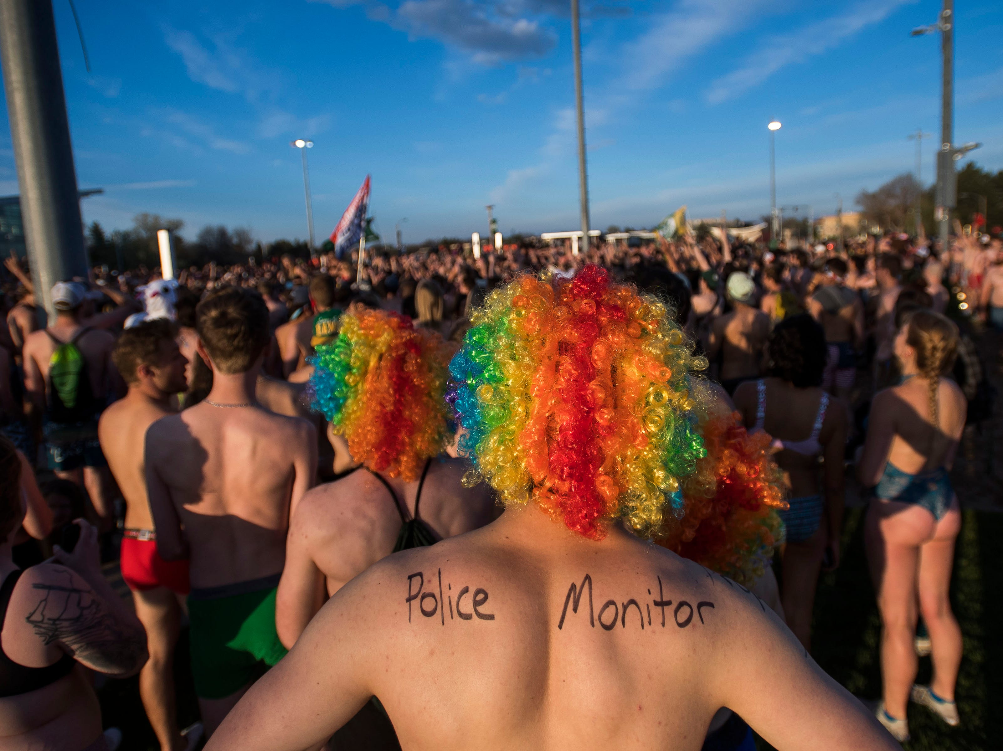 """Participants gather near the recreation center during the """"Undie Run"""" on Friday, May 10, 2019, on the Colorado State University campus in Fort Collins, Colo."""
