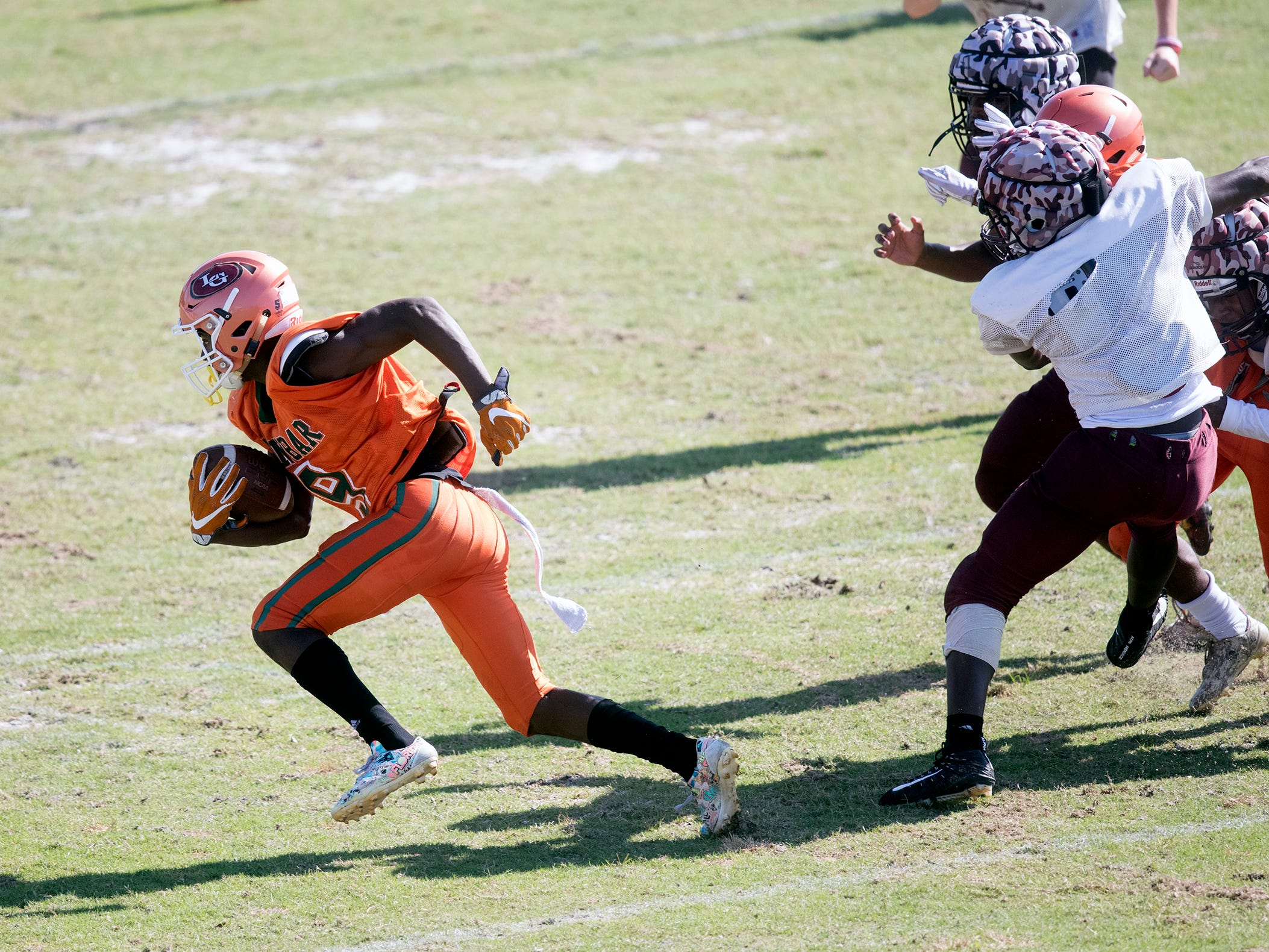 Dunbar High School's Greg Thomas, left, scores against Riverdale during a joint scrimmage on Saturday at North Fort Myers High School. Venice and North Fort Myers also played in the scrimmage.