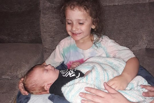 Liliana Zarrillo holds her baby brother, Canio.