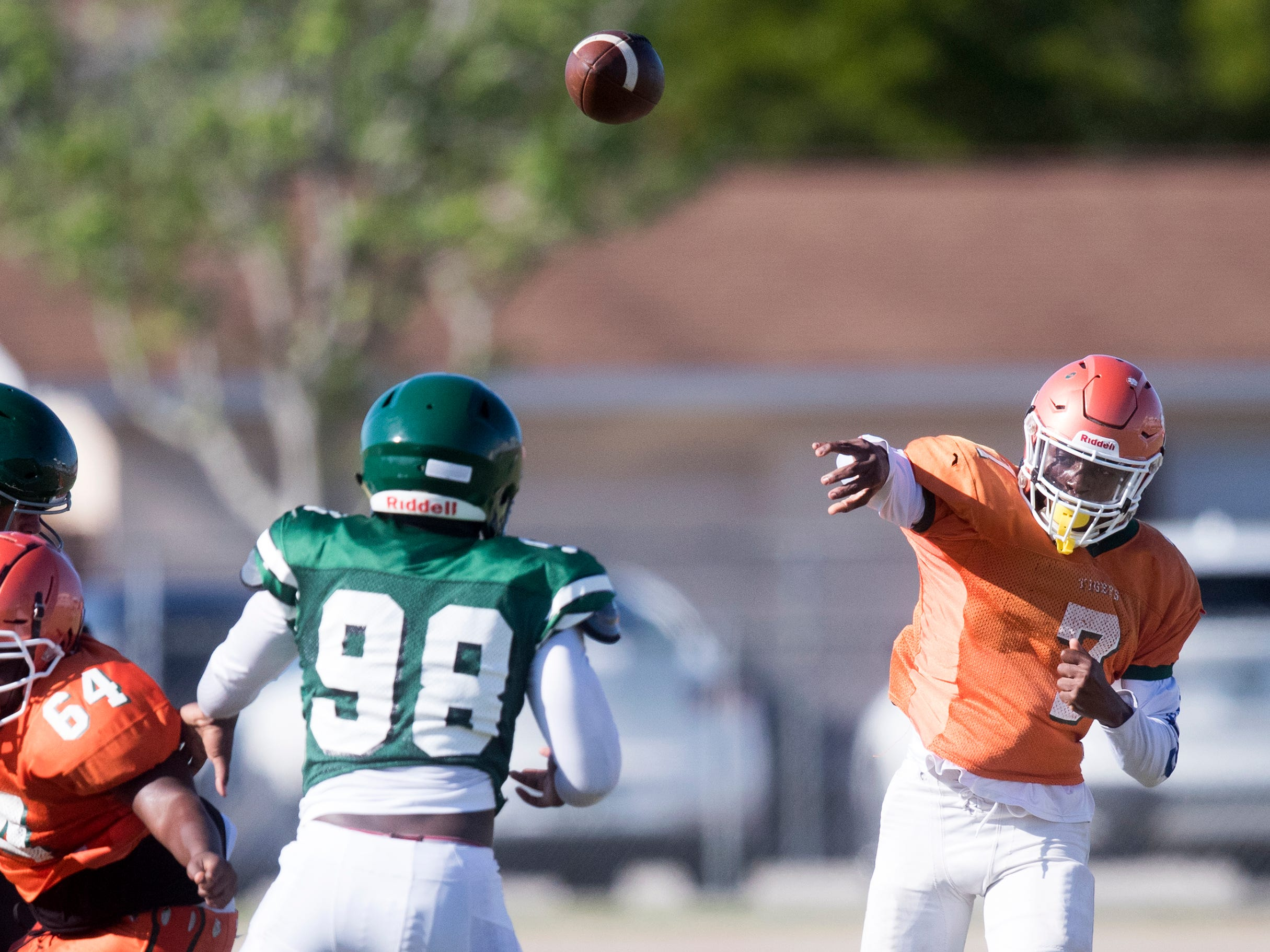 Dunbar High School's Jarques Riggins passes against Venice during a joint scrimmage on Saturday at North Fort Myers High School. Riverdale and North Fort Myers also played in the scrimmage.