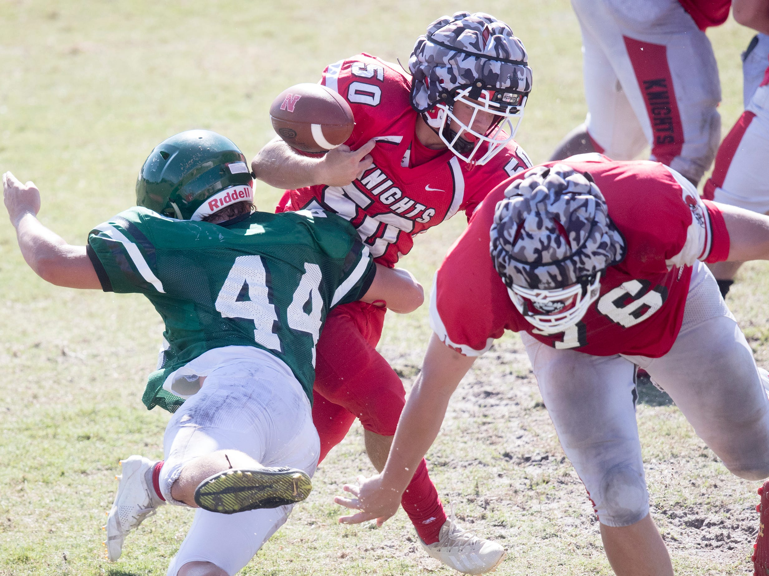 North Fort Myers High School's Brett Reed eludes Venice defenders during a joint scrimmage on Saturday at North Fort Myers High School. Riverdale and Dunbar also played in the scrimmage.