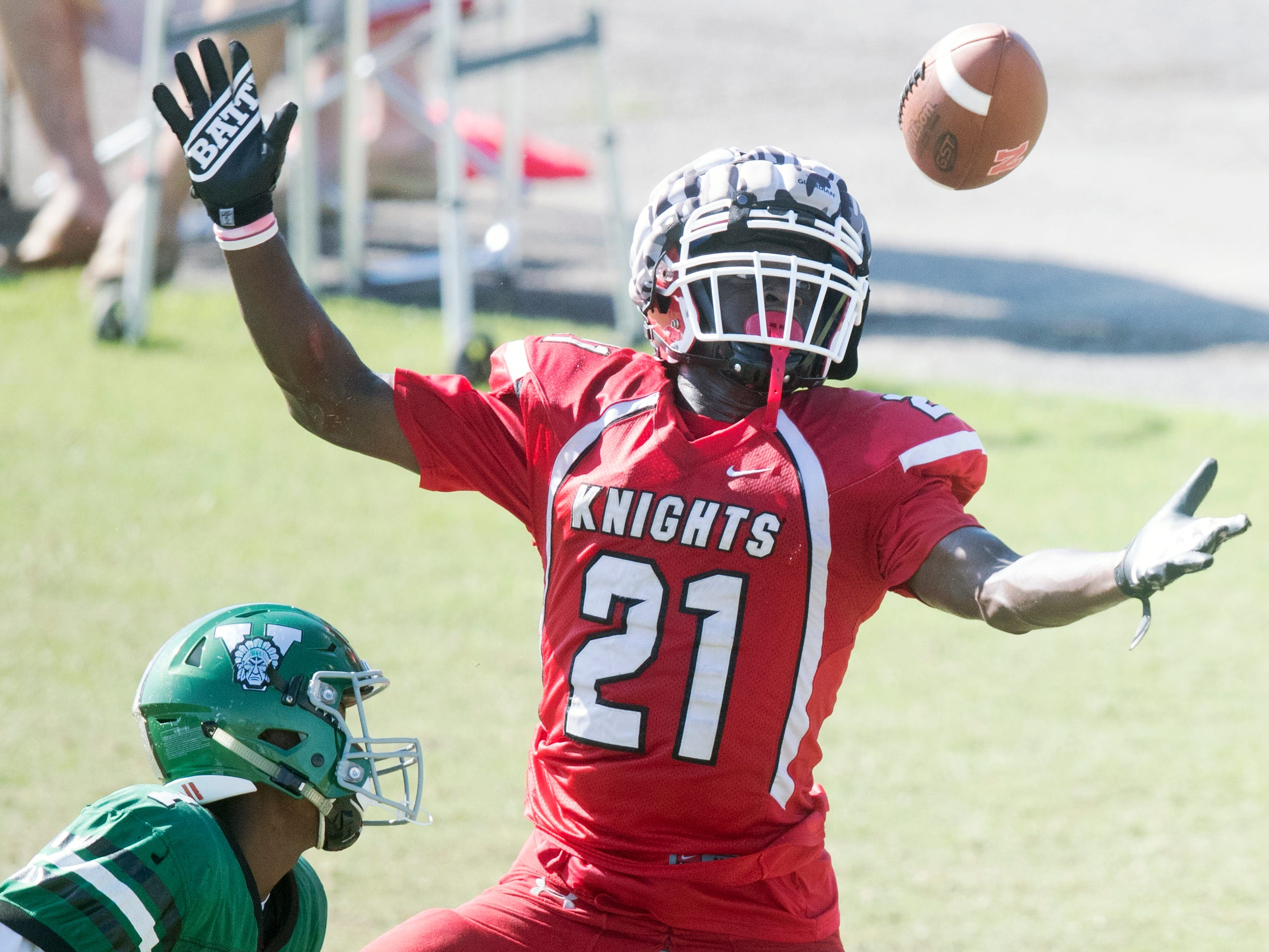 North Fort Myers High School's Daniel Pilgrim looks to catch a pass against Venice during a joint scrimmage on Saturday at North Fort Myers High School. Riverdale and Dunbar also played in the scrimmage.