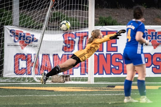 Eastside High School's Taylor Nutzman dives in an attempt to make a save as South Aiken scores a goal during their Class AAAA Championship game at Irmo High School in Columbia, Friday, May 10, 2019. South Aiken won 4-1.