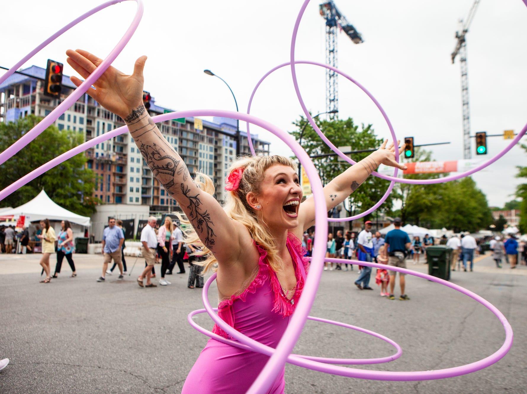 Chloe Wall preforms one of her hula hoop routines during Artisphere on Saturday, May 11, 2019.