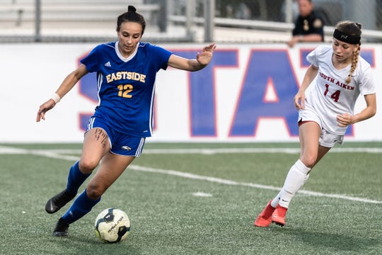 Eastside High School's Olivia Kelly dribbles down the field guarded by South Aiken's Allie McGarry during their Class AAAA Championship game at Irmo High School in Columbia, Friday, May 10, 2019. South Aiken won 4-1.