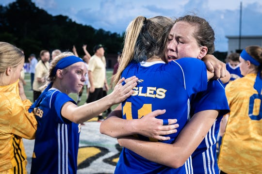 Eastside High School's Madelyn Schecter is embraced by teammate Leah Wilkins after their 4-1 Class AAAA Championship game loss to South Aiken at Irmo High School in Columbia, Friday, May 10, 2019.